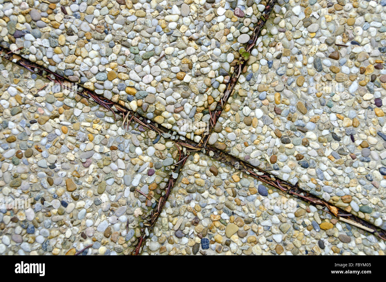 exposed-aggregate concrete with dirty gaps - Stock Image