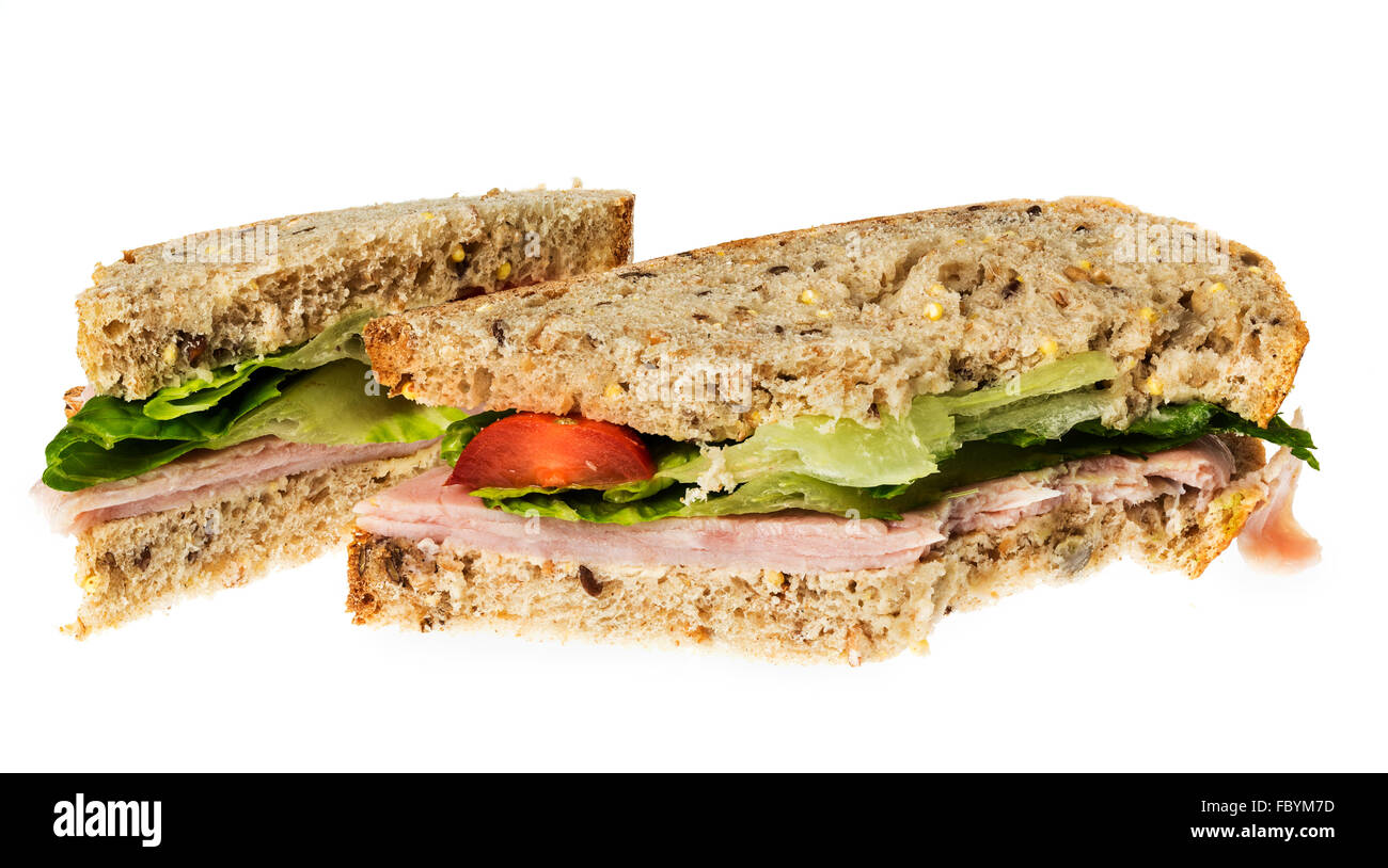 English multigrain bread ham sandwich with bite - Stock Image