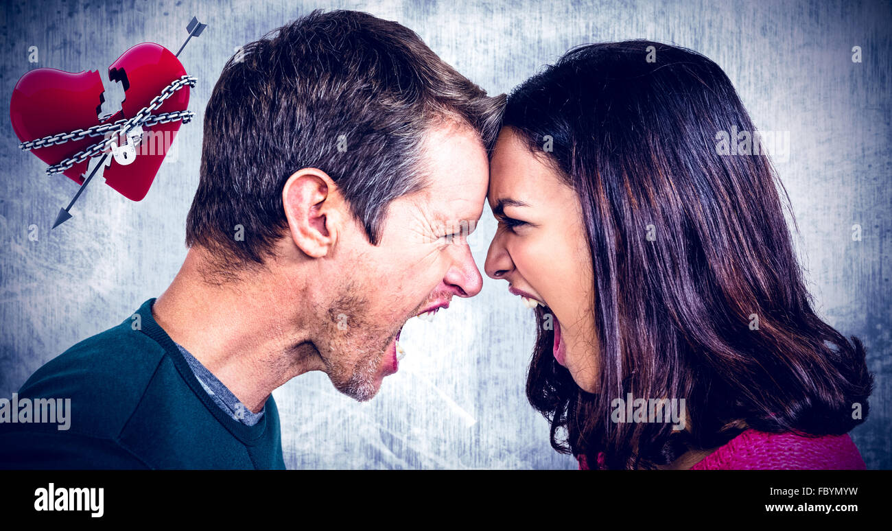 Composite image of couple yelling while standing head to head - Stock Image