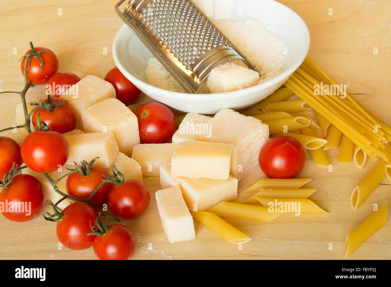 Italian grana padano, pasta  and tomatoes Stock Photo