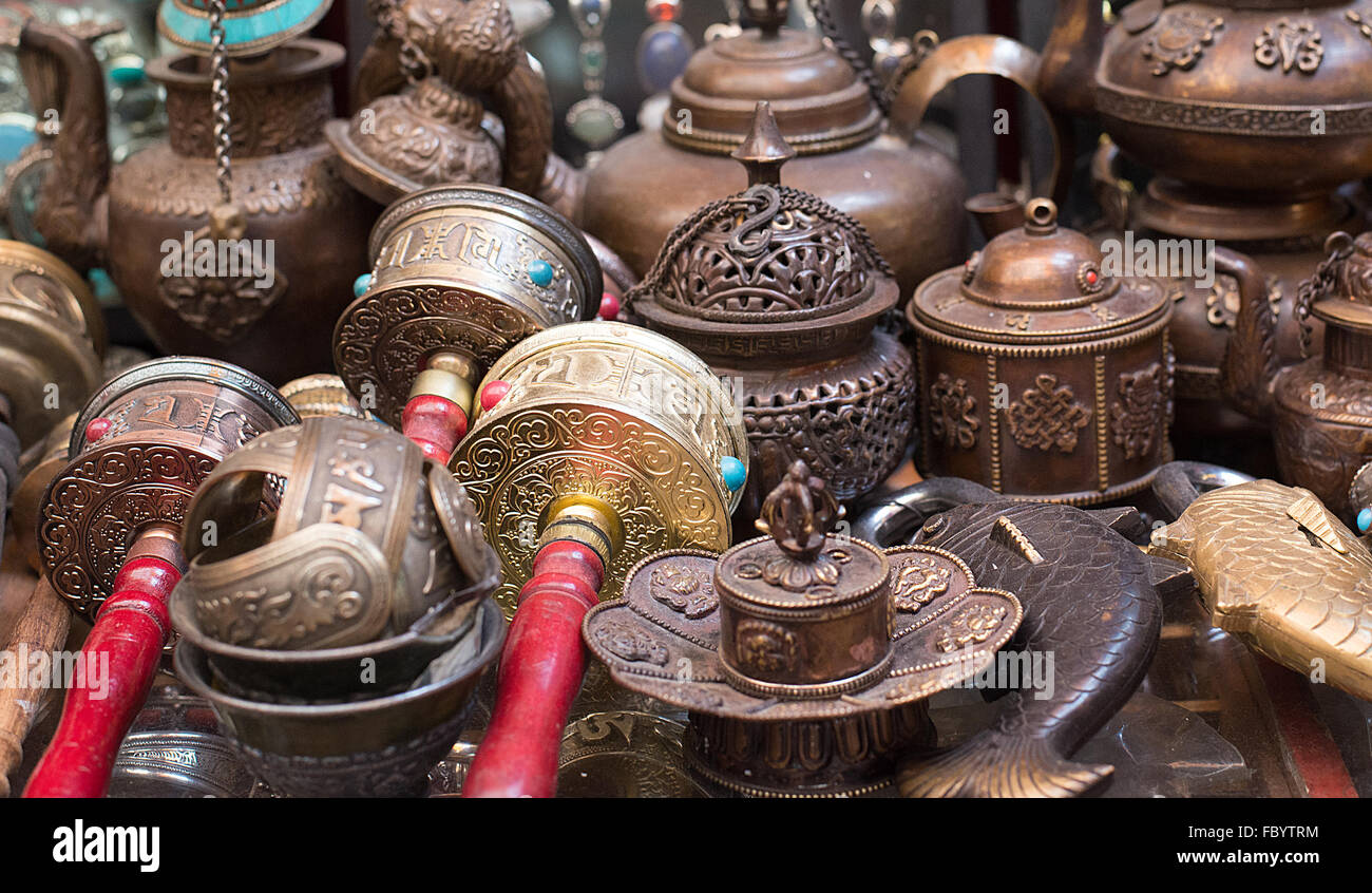 Prayer Wheels and other things at the souvenir market - Stock Image