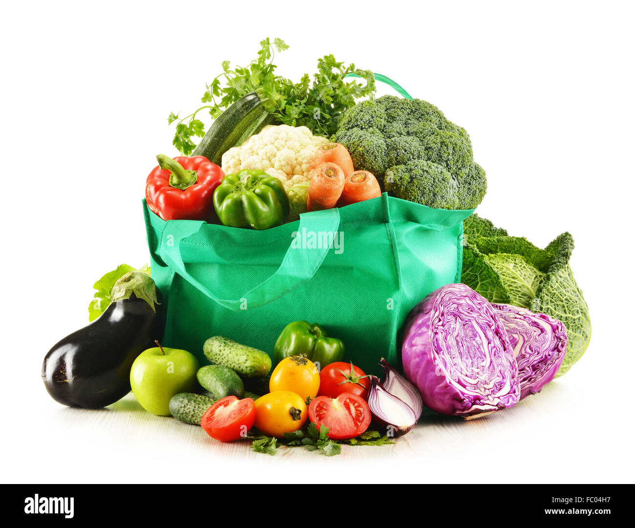 Shopping bag with variety of fresh organic vegetables isolated on white - Stock Image