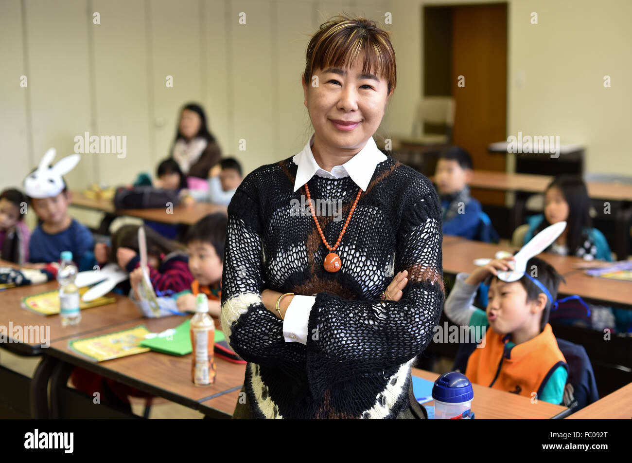 Oberursel, Germany. 22nd Nov, 2015. Junzi Yang, head of the International Chinese School, standing in a classroom - Stock Image