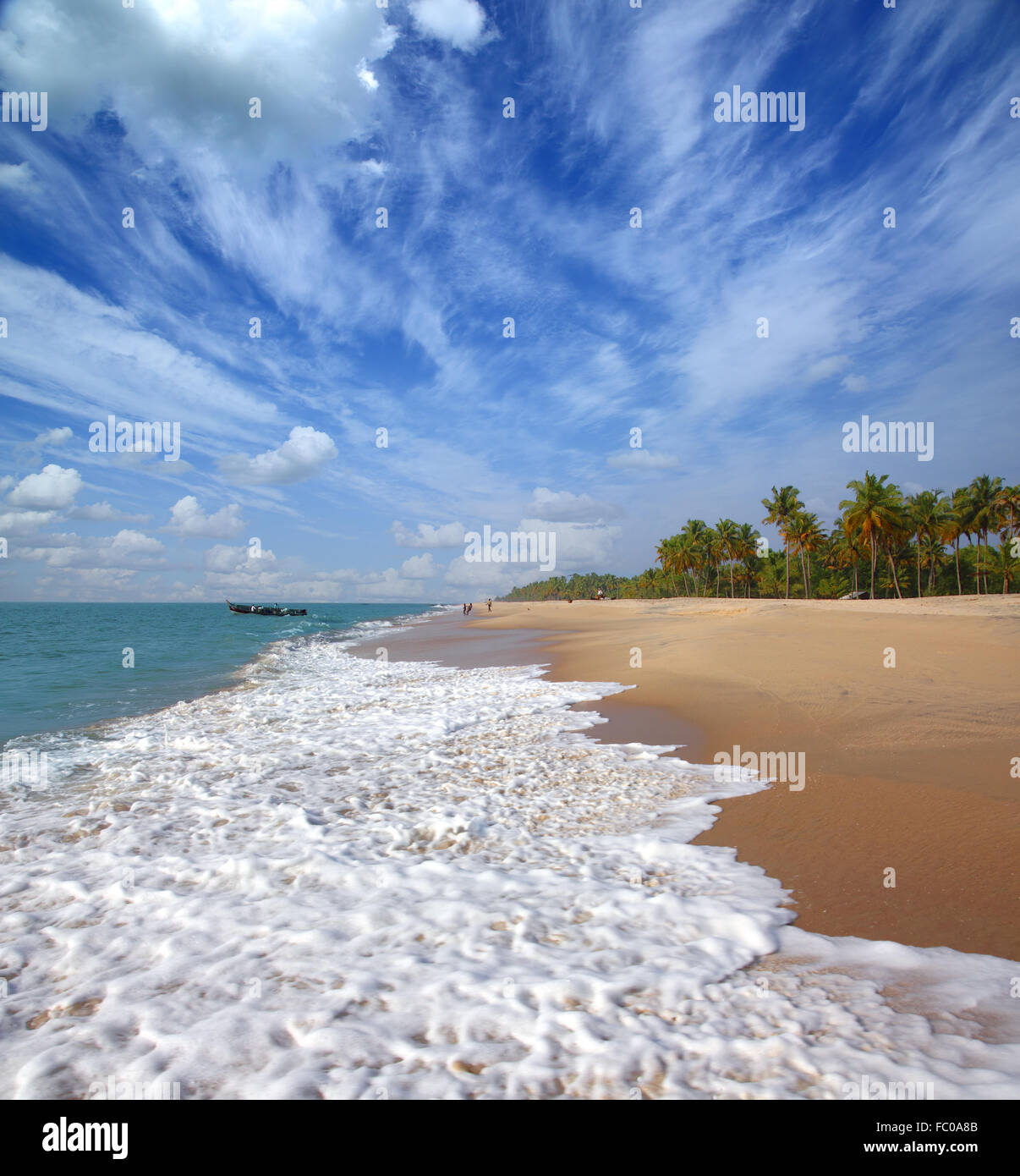 beach landscape with fishermen in India - Stock Image