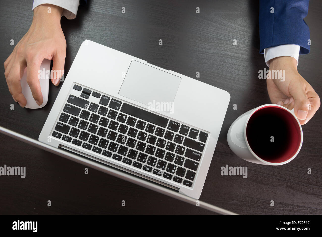 man in suit working in office desk, grabing cup of coffee, top view Stock Photo