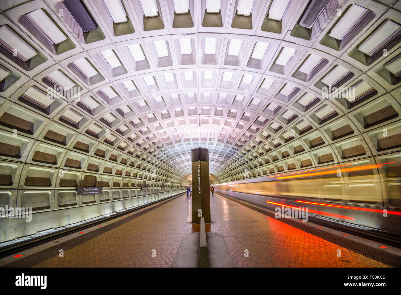 WASHINGTON, D.C. - APRIL 10, 2015: Trains and passengers in a Metro Station. Opened in 1976, the Washington Metro - Stock Image