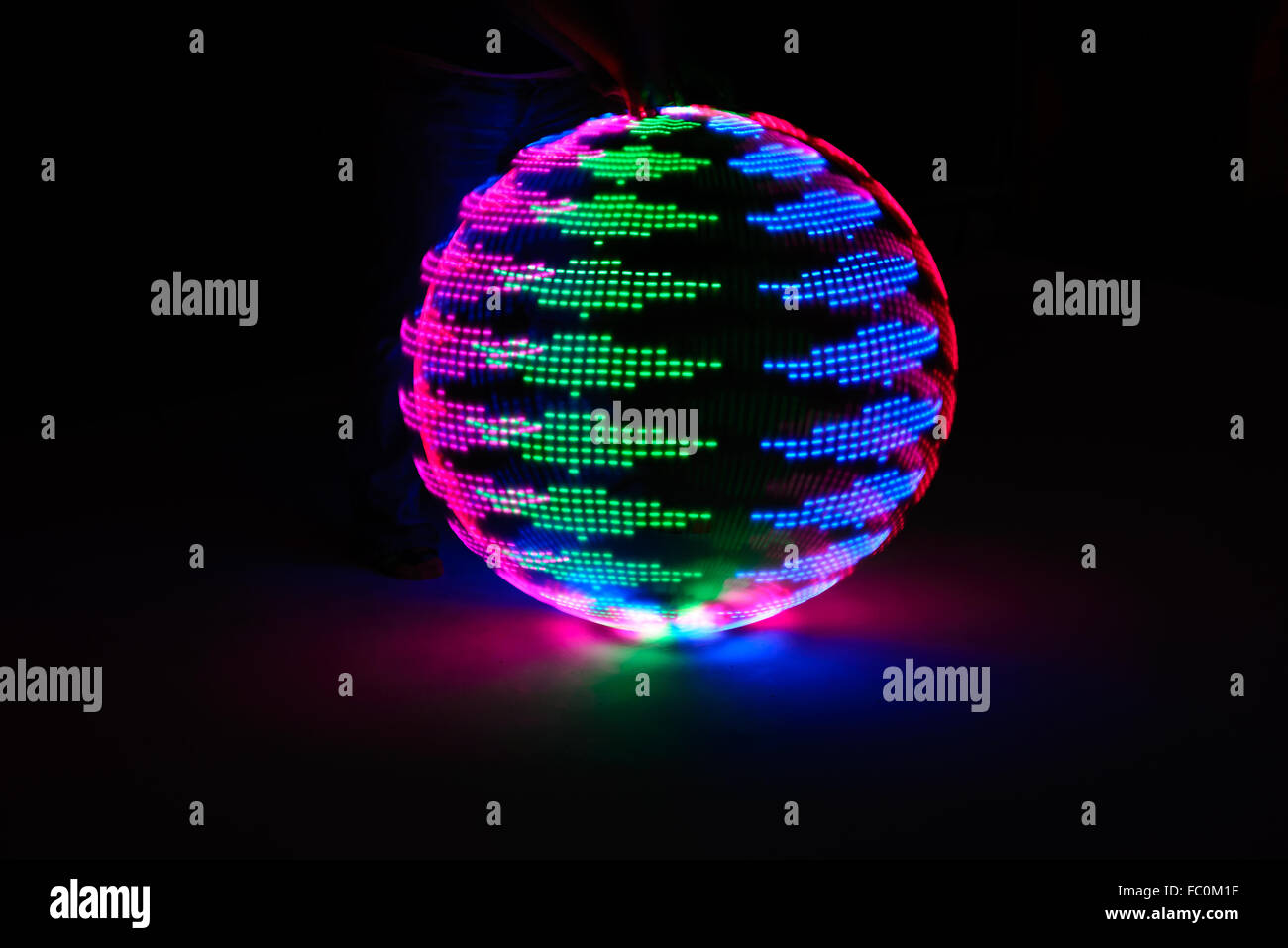 Beautiful random LED light painting in the darkness, long exposure technique, color full flower, globe spinning - Stock Image