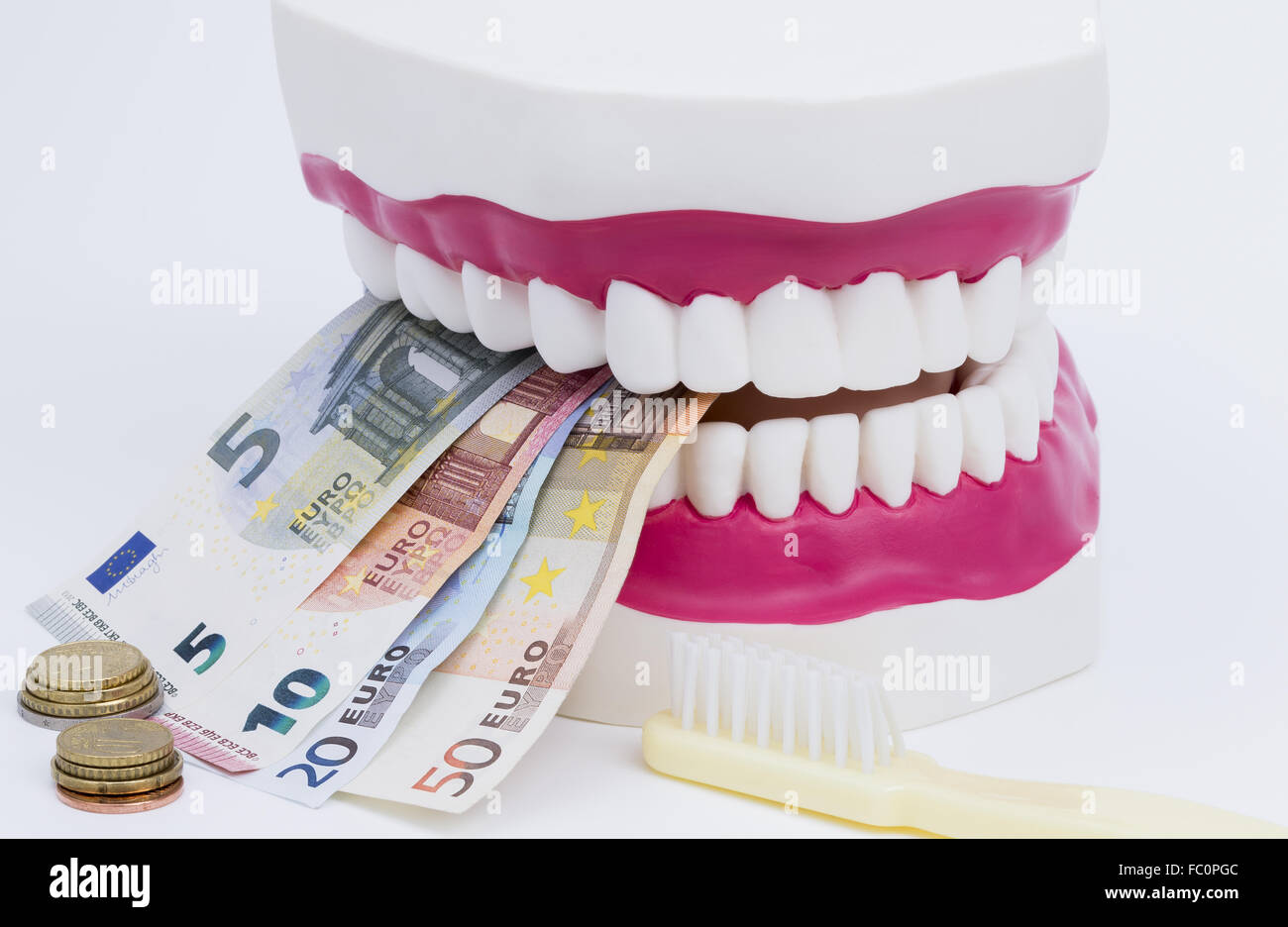 Tooth model with money Stock Photo
