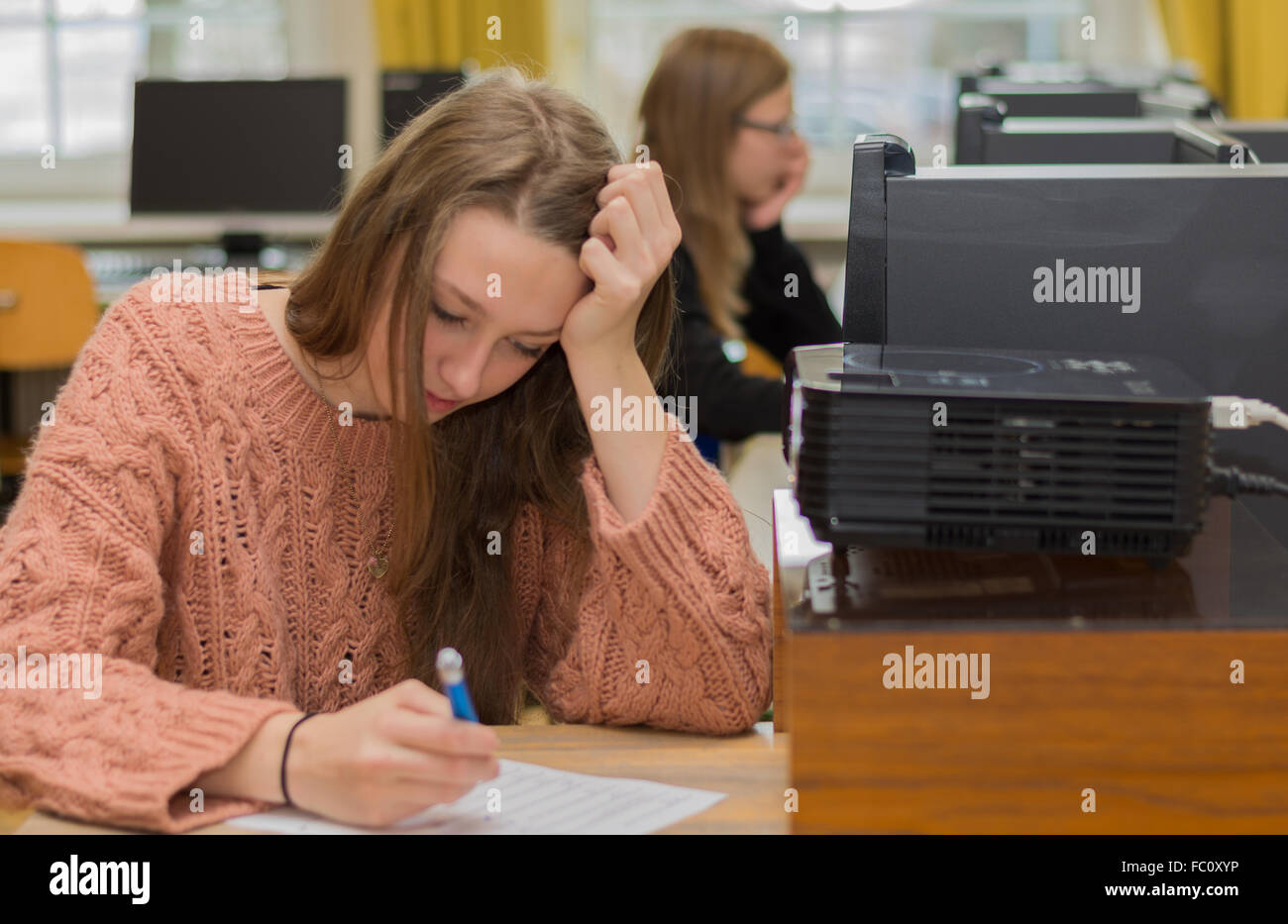 Student makes a written test - Stock Image