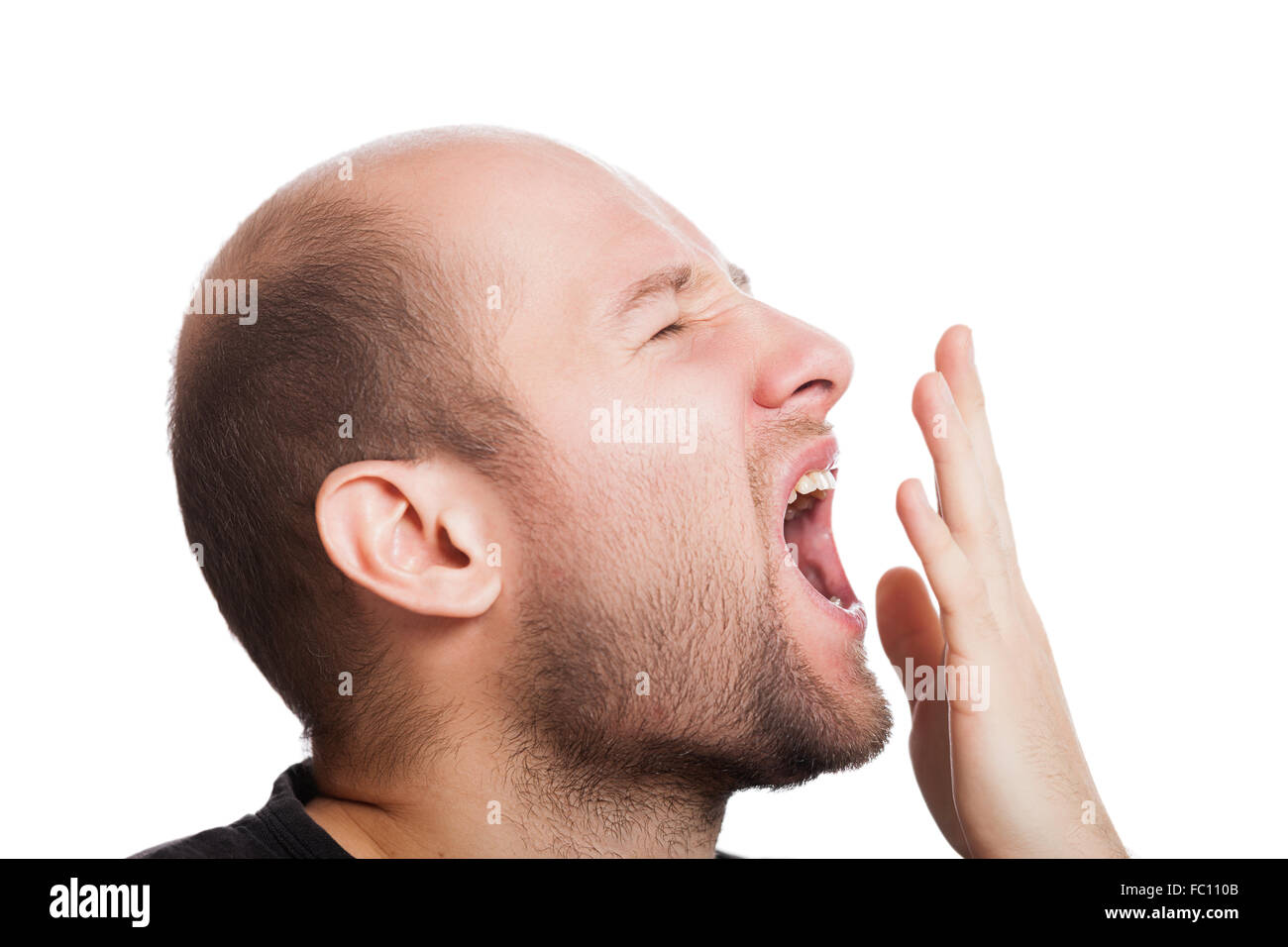 Tired man wide open mouth yawning - Stock Image