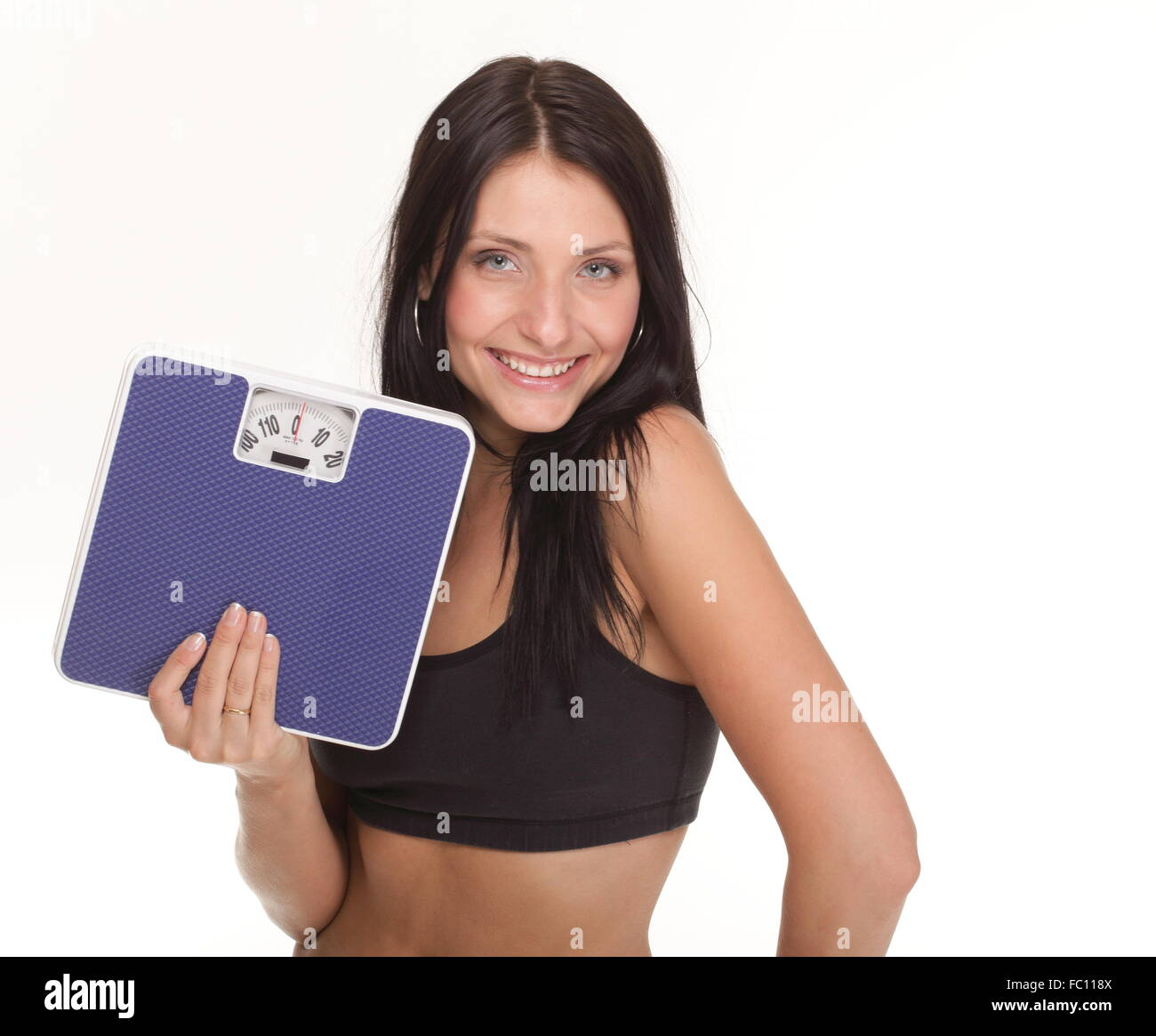 Weight loss woman on scale unhappy - Stock Image
