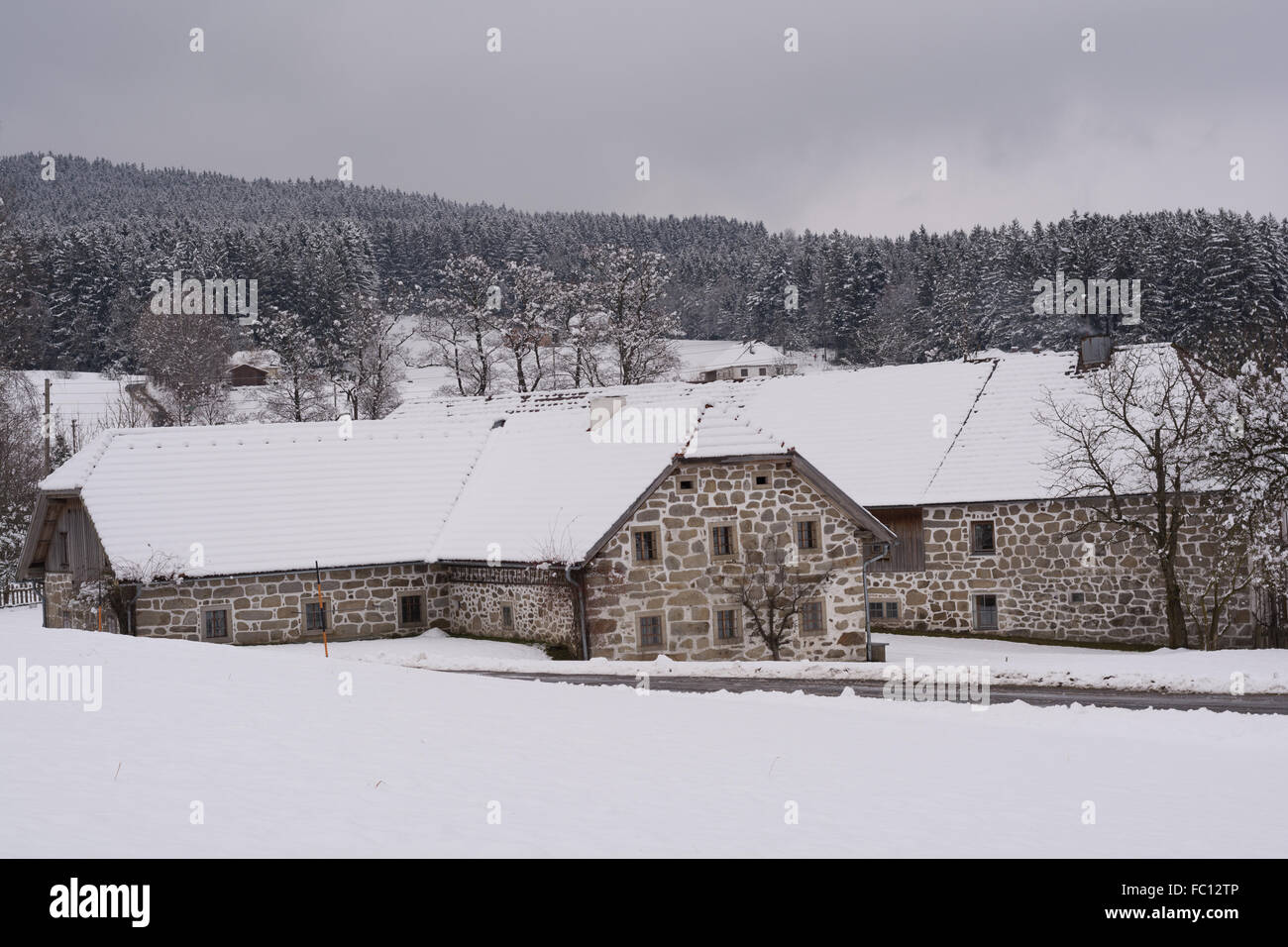 old farms in winter landscape - Stock Image
