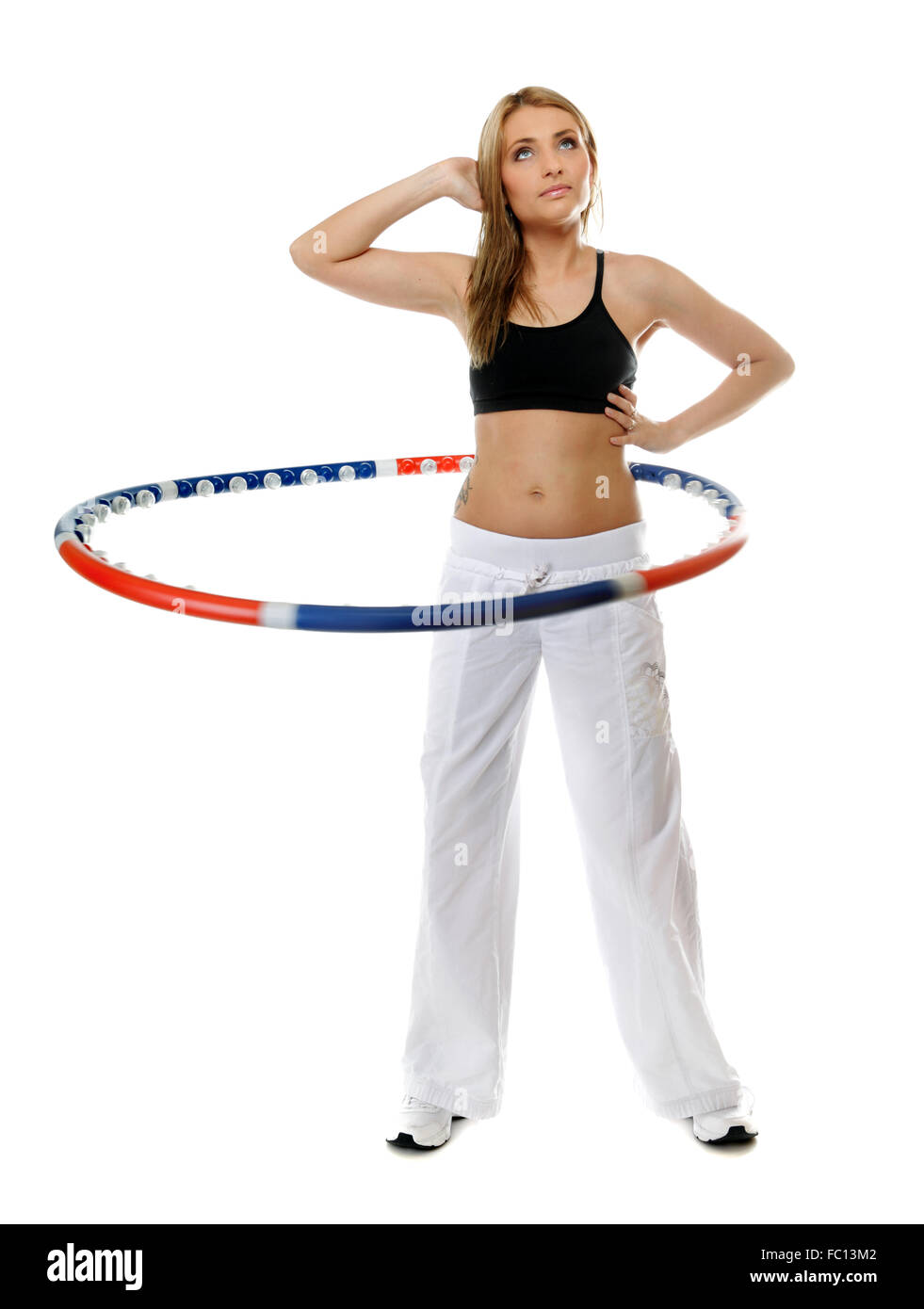 young fitness woman with hula hoop isolated - Stock Image