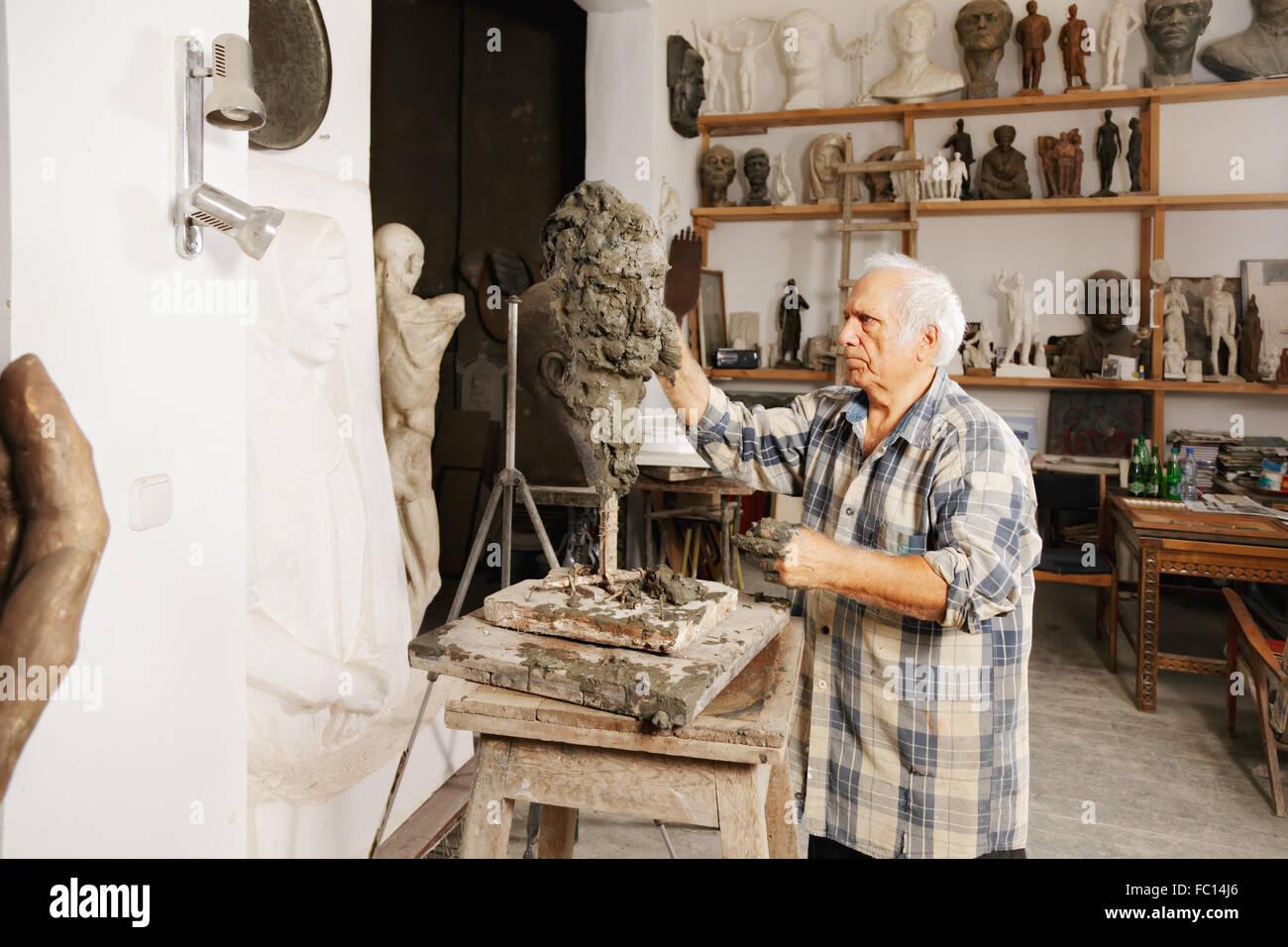 Sculptor creates head - Stock Image