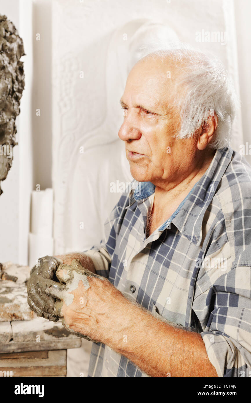 Portrait of elderly sculptor - Stock Image