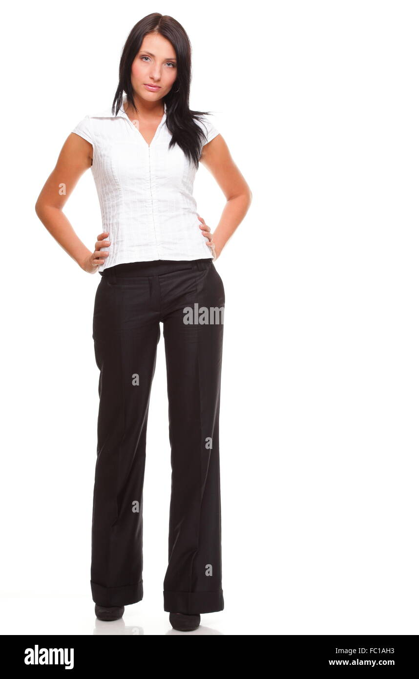 Portrait of a happy young business woman standing full lenght - Stock Image