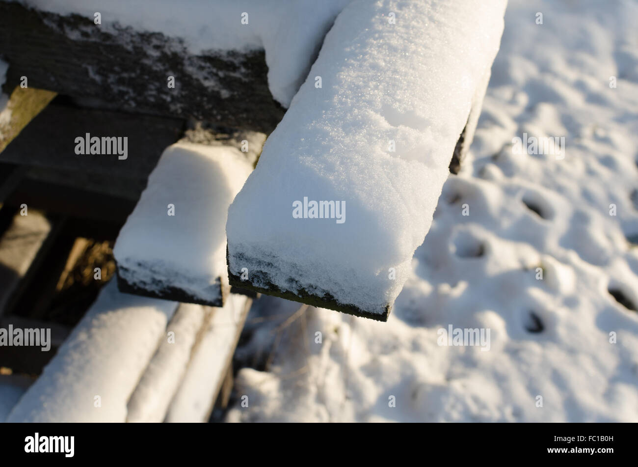 Snow covered wooden pallet - Stock Image