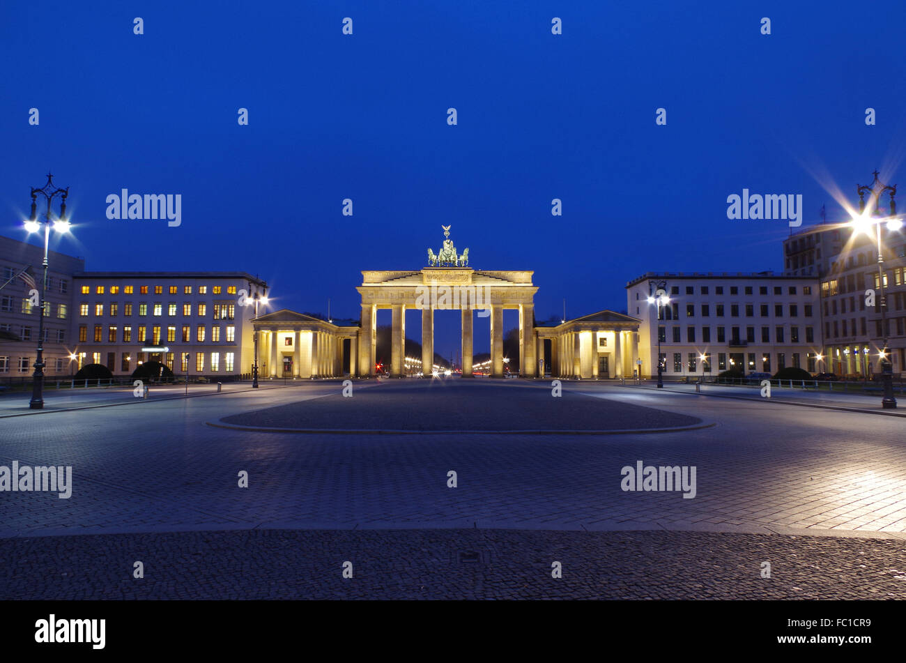 brandenburg gate in berlin at blue our - Stock Image