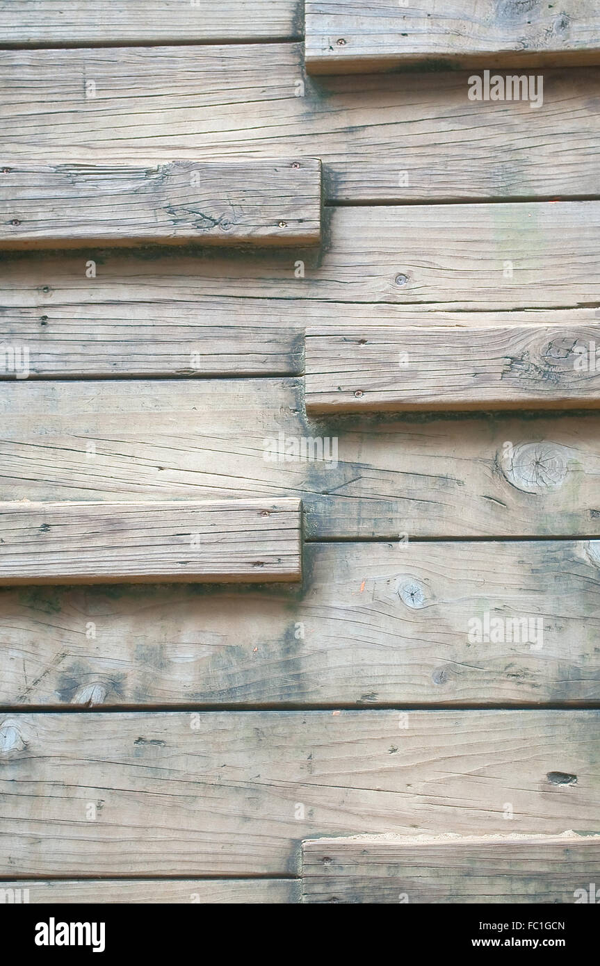 Polished wood vertical steps kept outdoor, long time washed by rain and sunlight - Stock Image