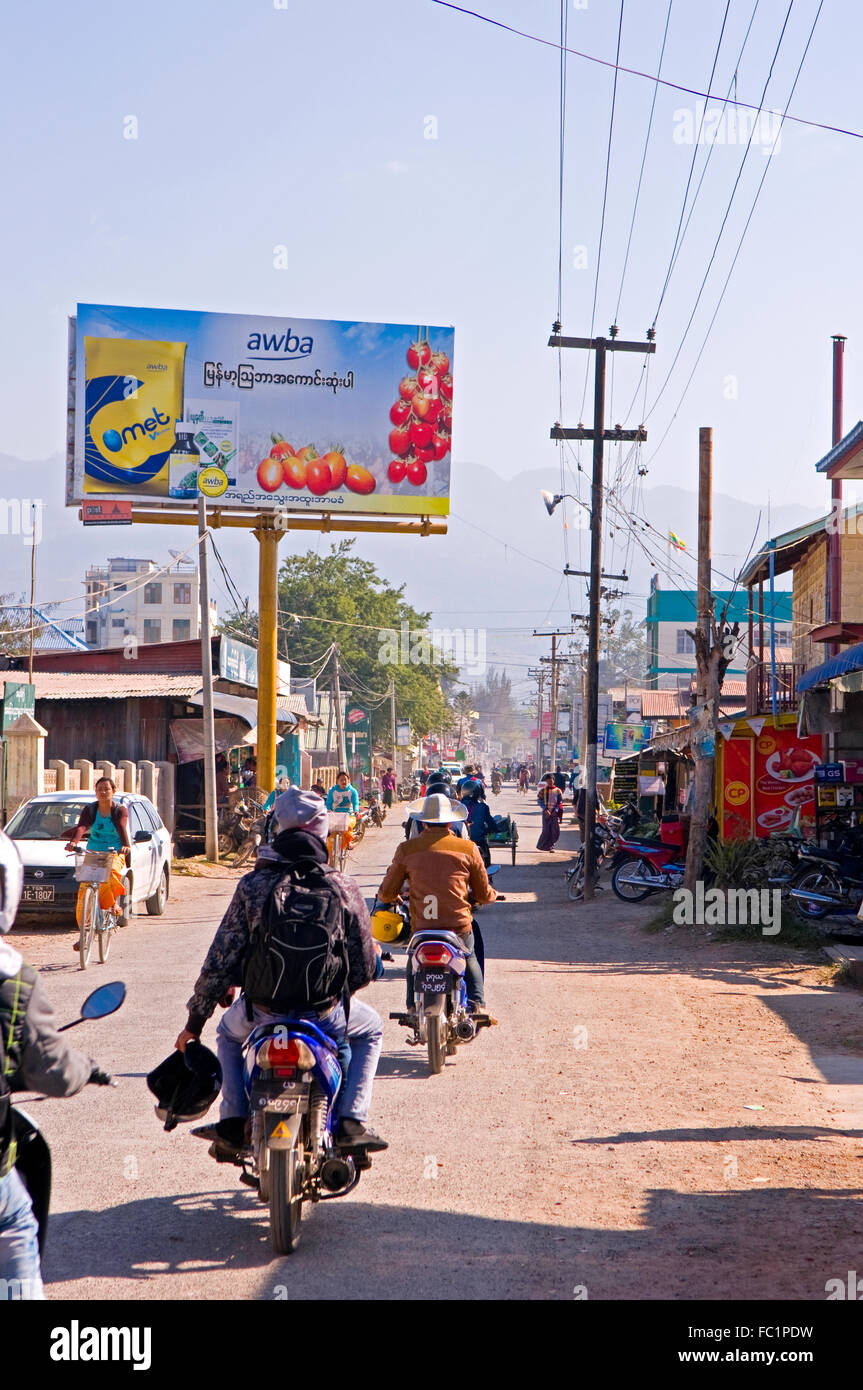 A typical street in Nyaung Schwe, Myanmar - Stock Image