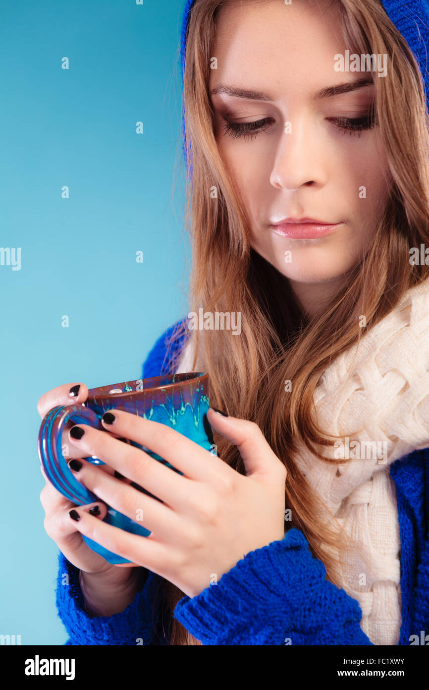 Teen Girl Holding Blue Mug With Hot Drink