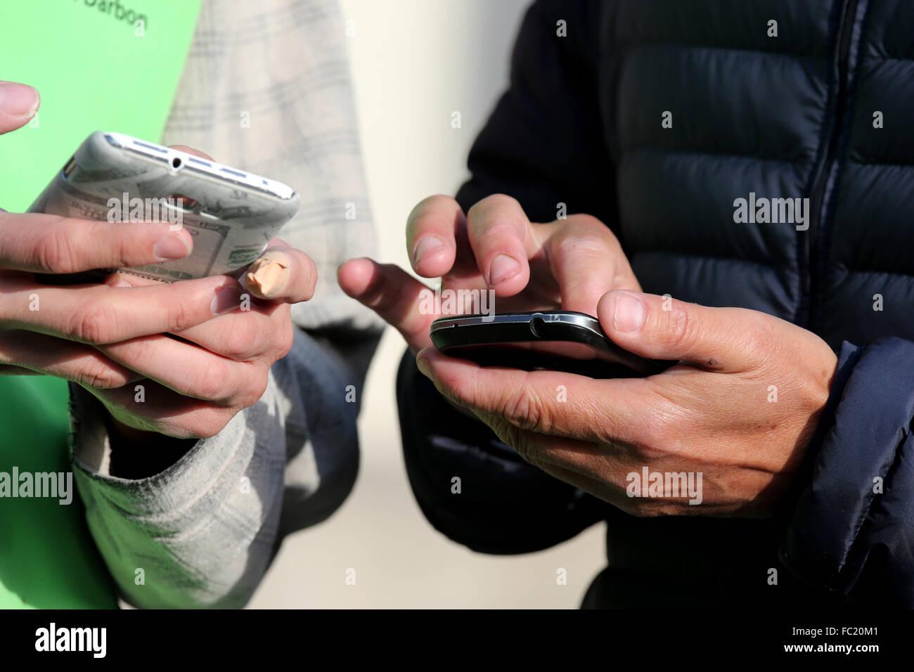 Men using Smartphones. - Stock Image