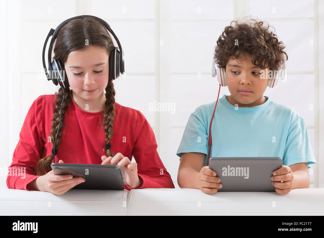 CHILD WITH TABLET - Stock Image