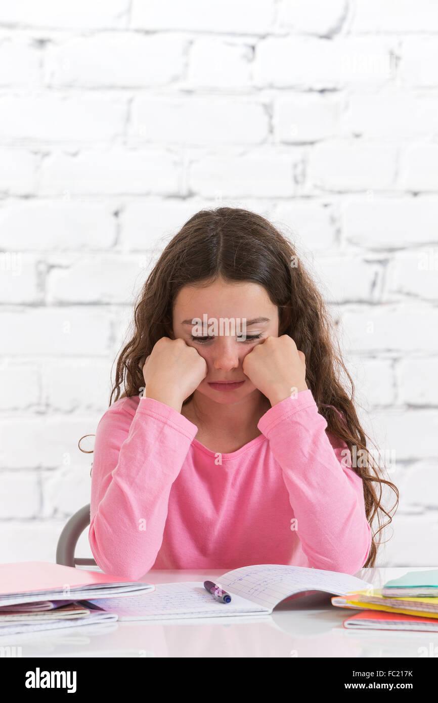 CHILD DOING HOMEWORK - Stock Image