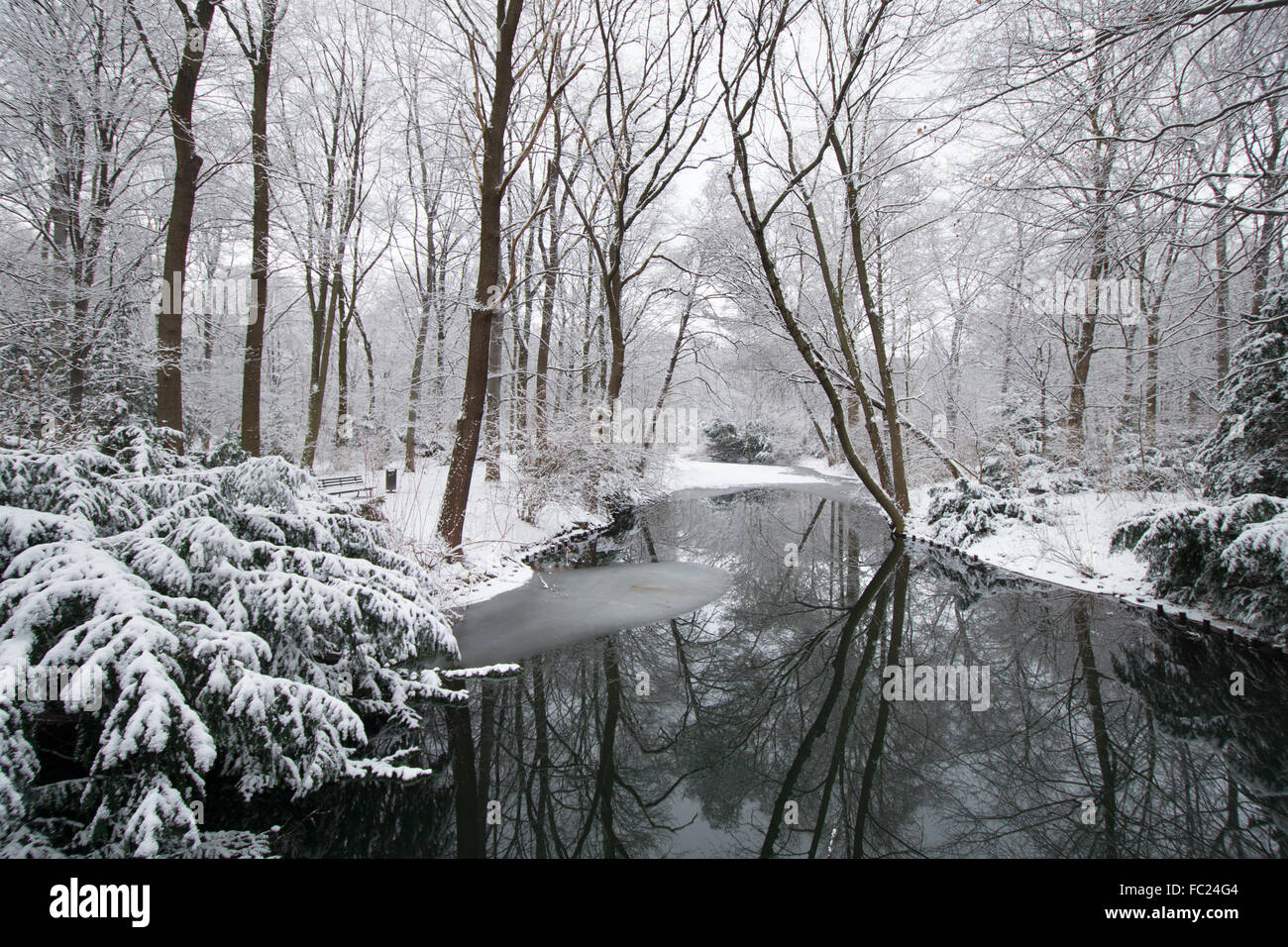 Snow covered parkland in Tiergarten Park in central Berlin in winter 2016, with monuments and trees and lake Berlin - Stock Image