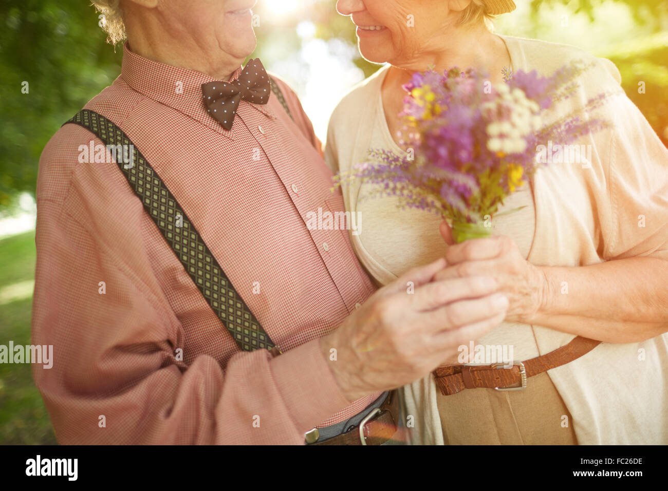 Romantic seniors in embrace enjoying being together - Stock Image