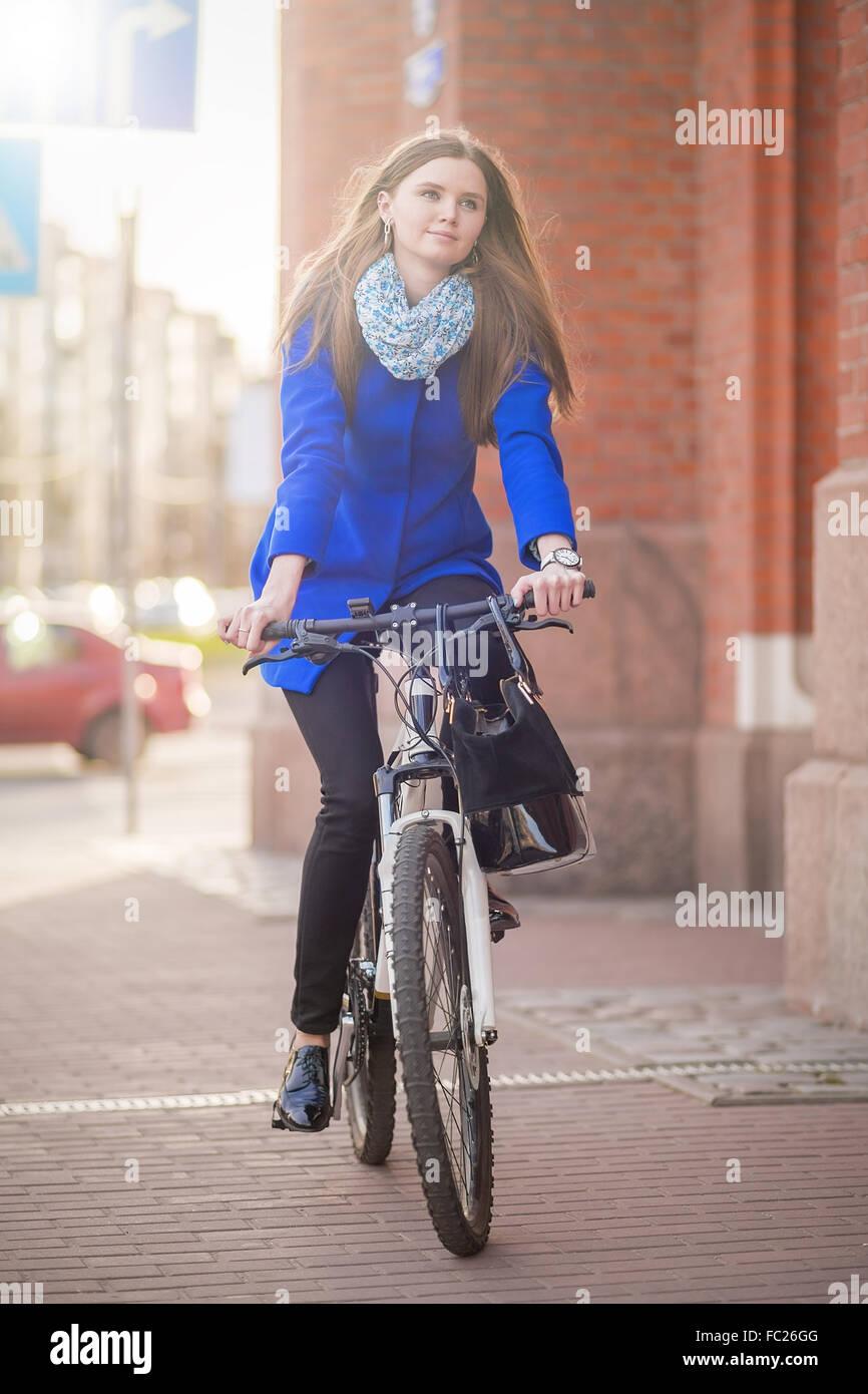 woman drives on bike - Stock Image