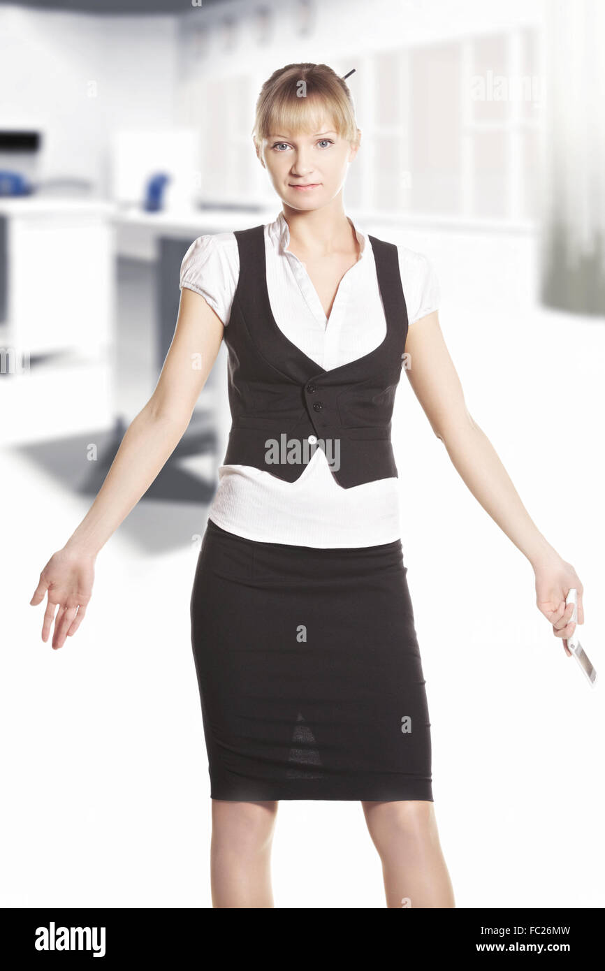 Shrugging woman at the office - Stock Image