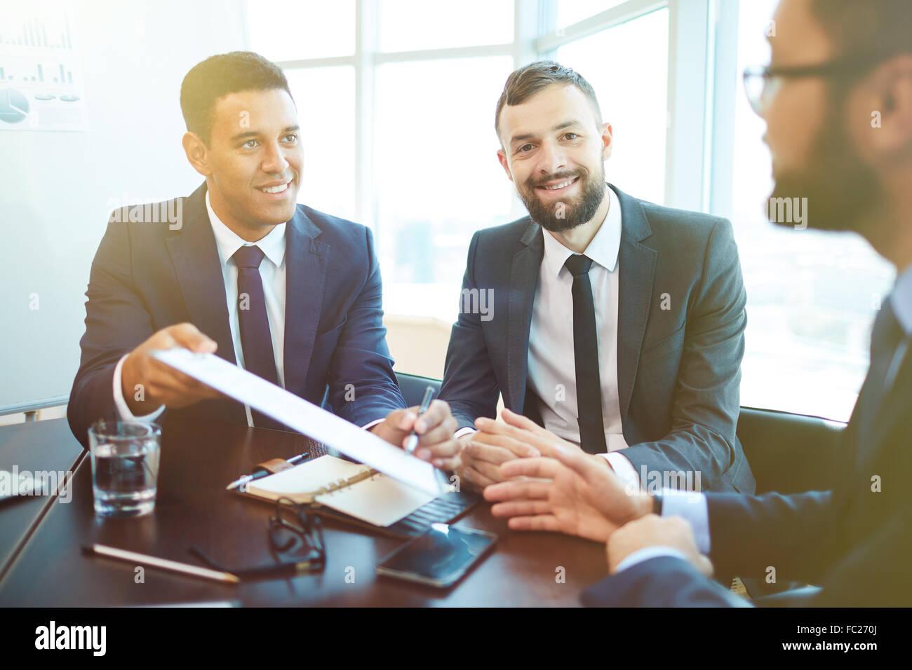 Successful businessmen striking deal after negotiation - Stock Image