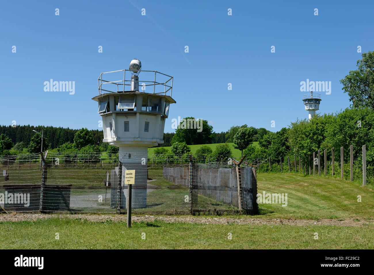 Watchtower on the border with East Germany, wall and barrier in the divided village Mödlareuth - Stock Image