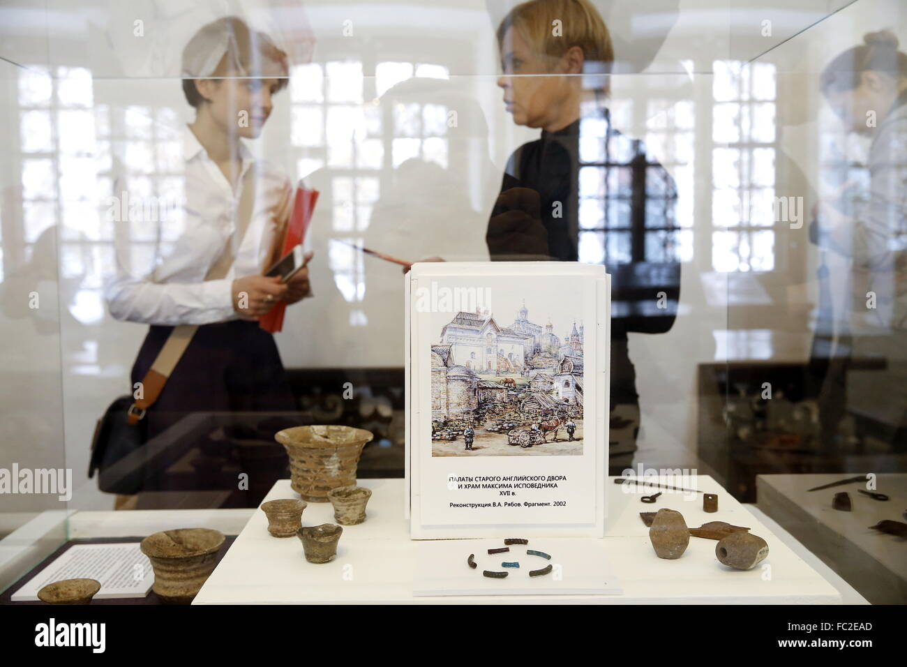 Moscow, Russia. 20th Jan, 2016. Visitors view a display of artefacts and a picture showing an artist's impression - Stock Image