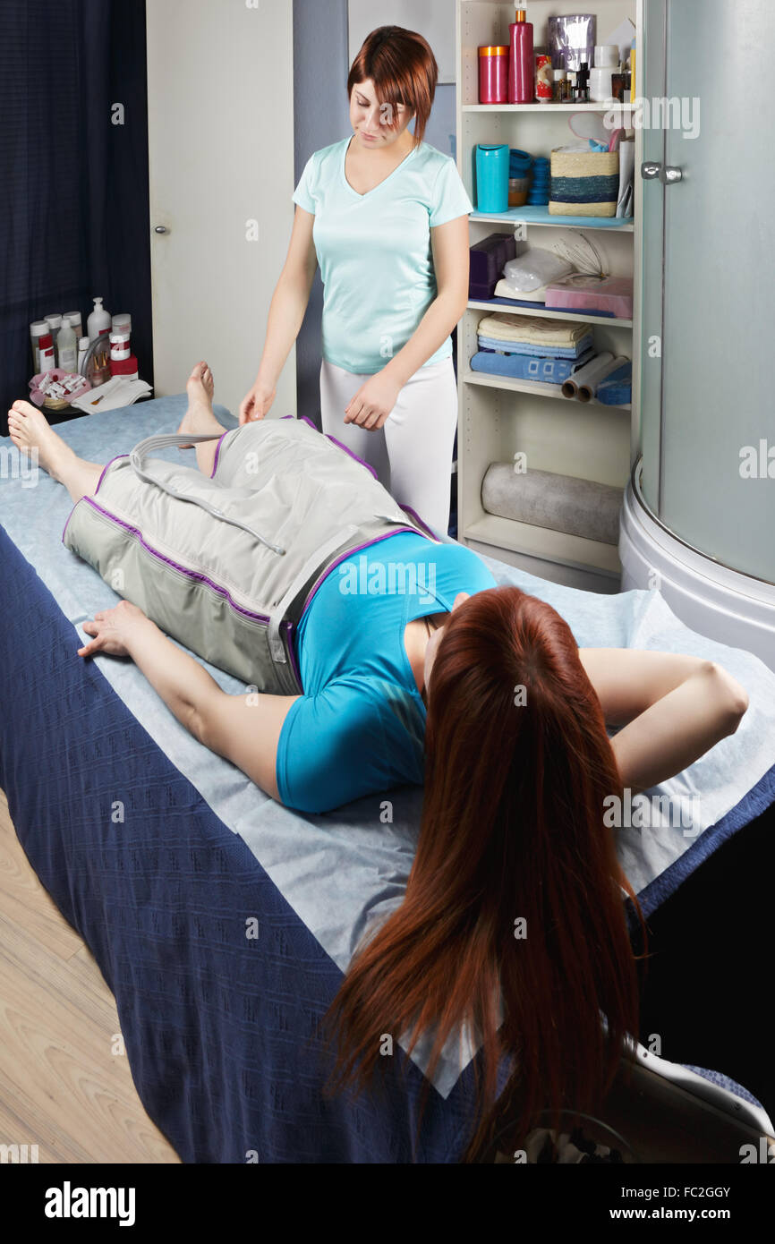 Air compression massage procedure - Stock Image