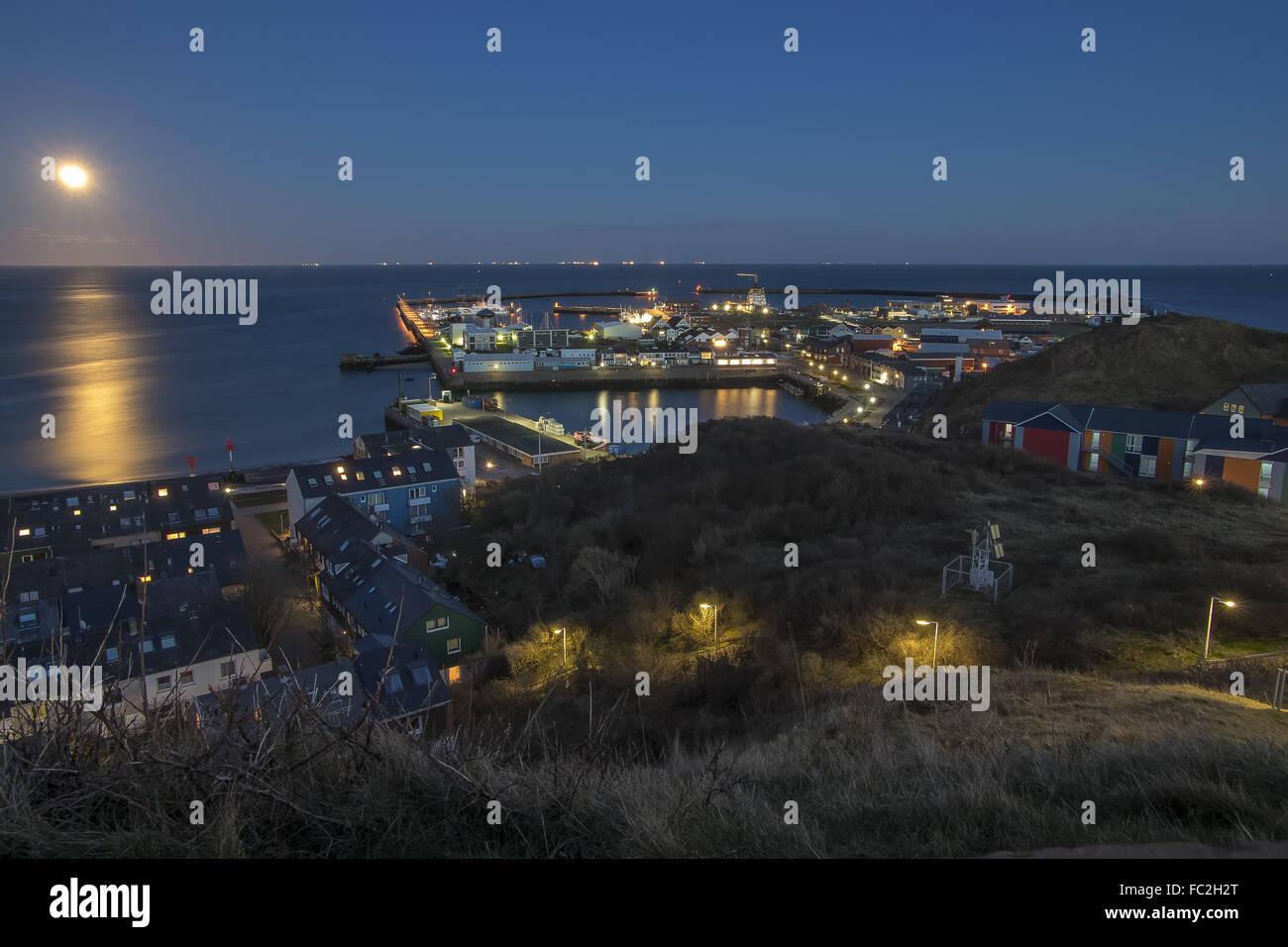 Full moon over the harbor of Heligoland - Stock Image