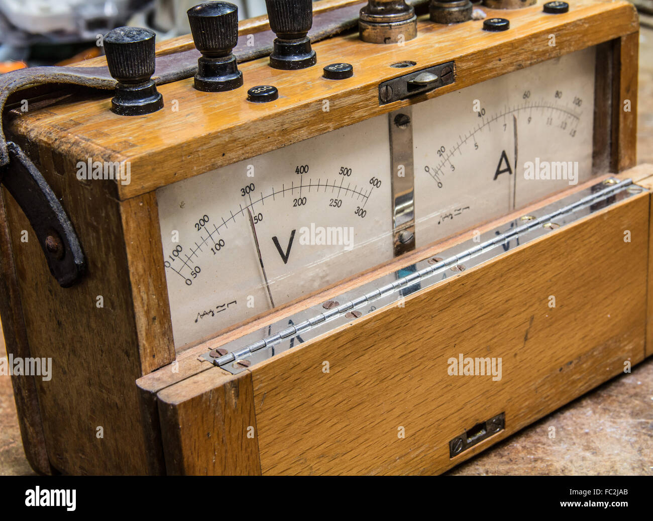 Vintage analog wooden electric meter on the old table test - Stock Image
