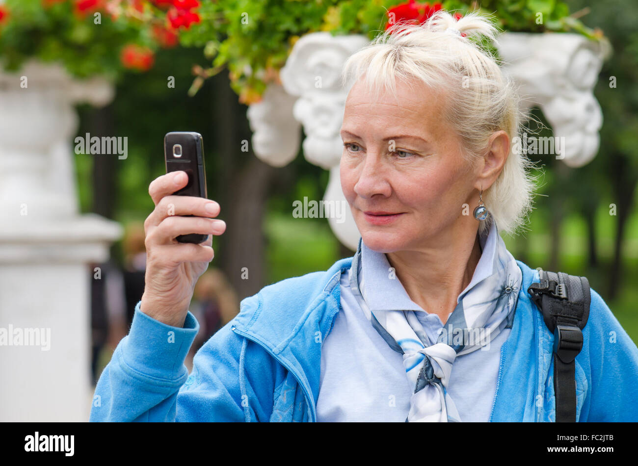 woman photographed in a park on the phone - Stock Image