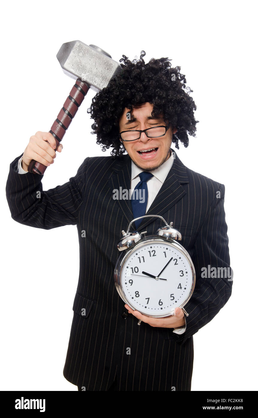 Businessman holding hammer and alarm clock isolated on white - Stock Image