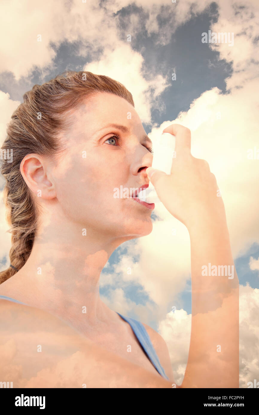 Composite image of woman using inhaler for asthma - Stock Image