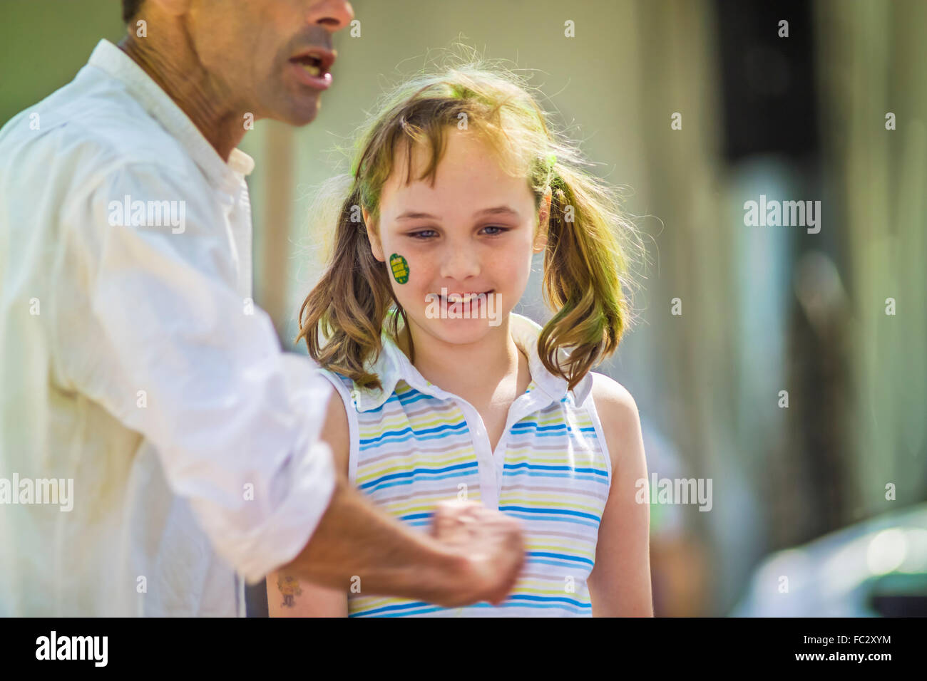 Young girl with The Wave.Storytellers Ellis Pearson & Bheki Mkhwane an institution on the lawns in South Africas - Stock Image
