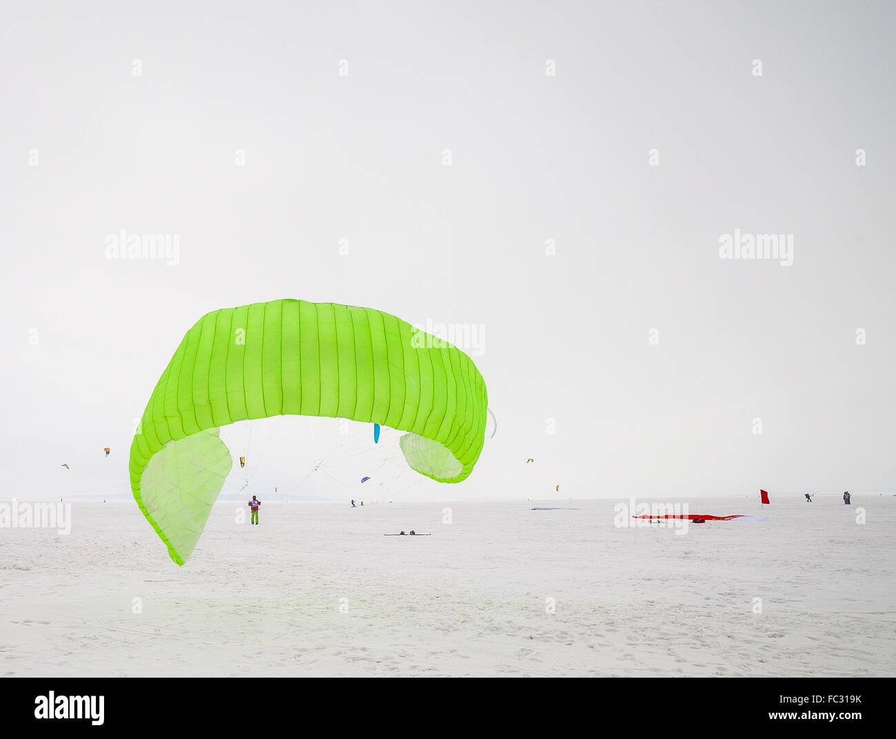 Kiteboarder with kite on the snow Stock Photo