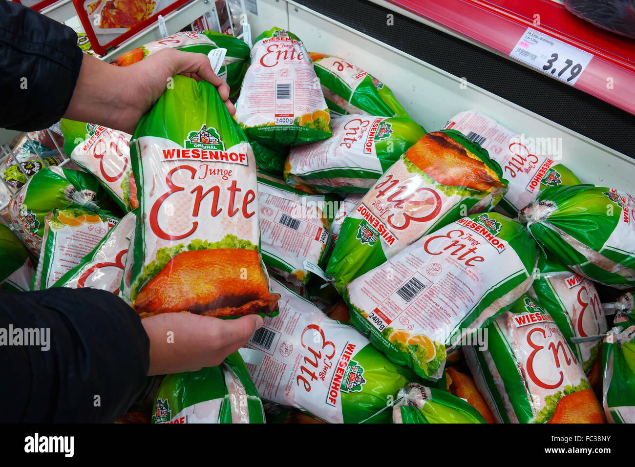 Poultry, deep frozen duck packings in a supermarket - Stock Image