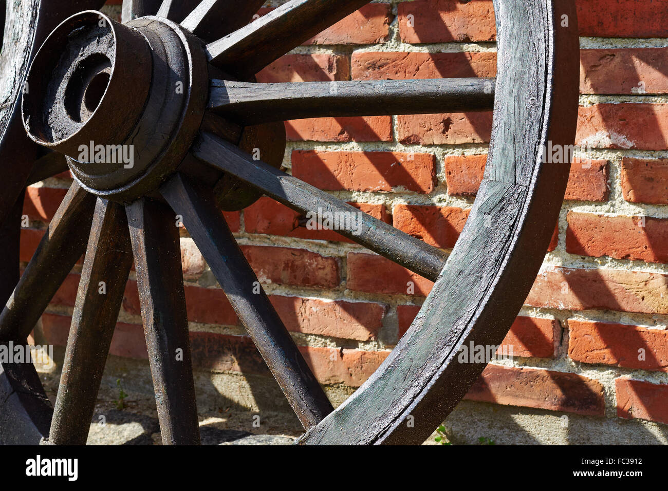Old Wooden Cartwheel - Stock Image