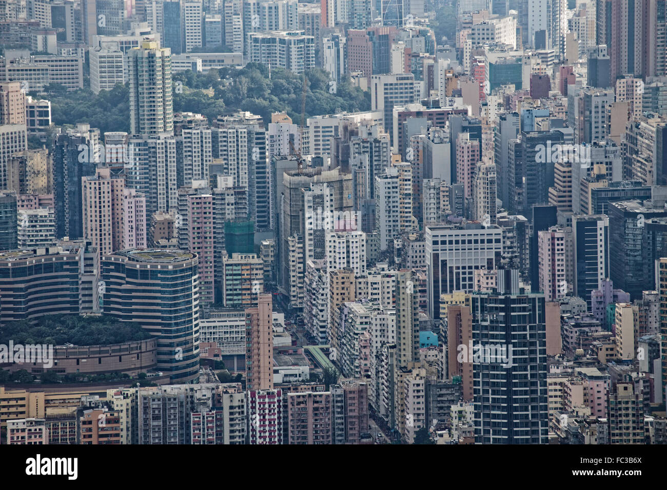 Hong Kong cityscape, crowd buildings in mist - Stock Image
