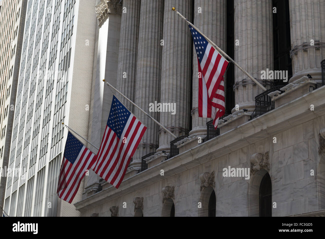 American flags and stock exchange - Stock Image