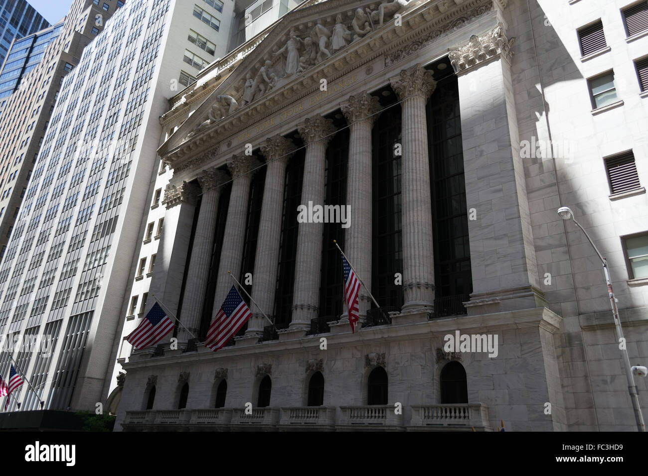 Flags at the stock exchange building - Stock Image
