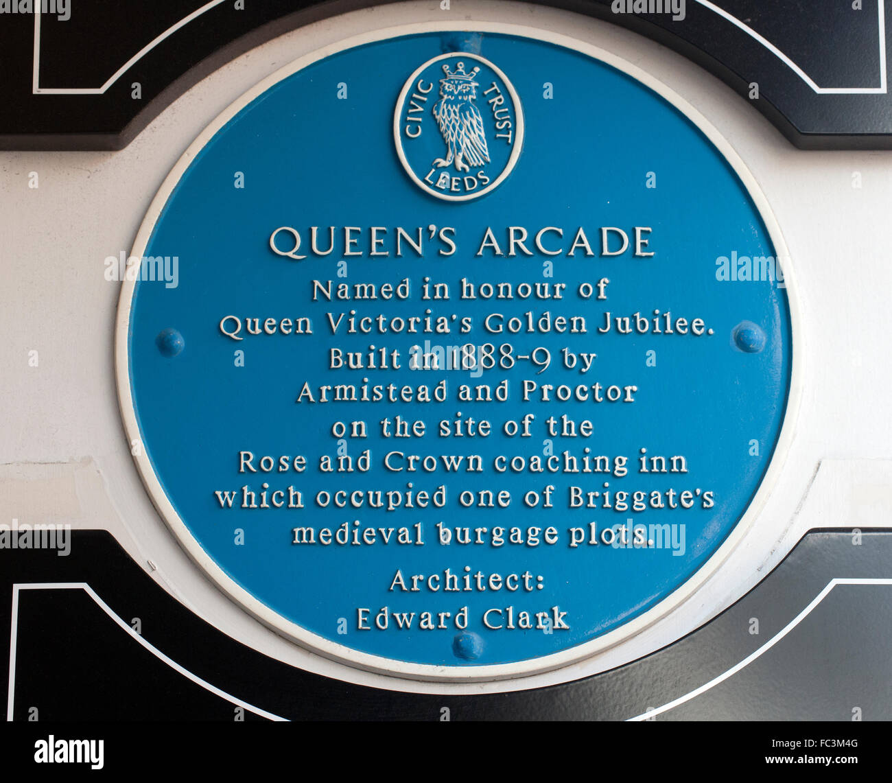 Blue plaque at Queen's Arcade, Victorian Quarter, Leeds, South Yorkshire, England, UK. - Stock Image