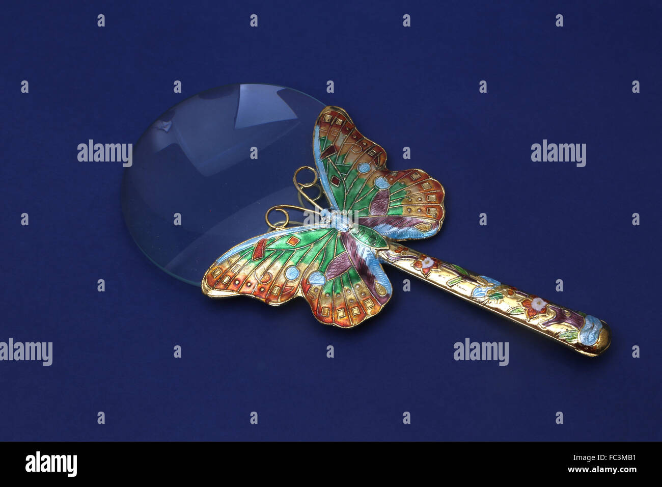 Magnifying Glass With Cloisonne Enamel Butterfly Design - Stock Image